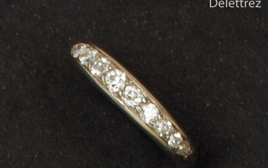White gold wedding band, adorned with old-fashioned falling...