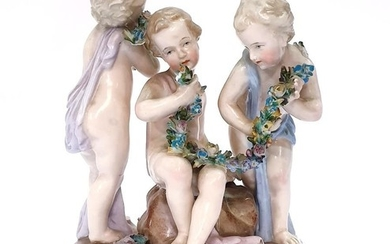 A 19th Century continental figural group of three young boys...