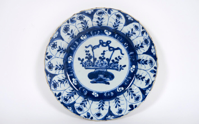 "17th century Chinese Kang Hsi plate in porcelain with blue and white decor with jardiniere - diameter : 22 cm - with a nice wooden stand|||17th Cent. Chinese ""Kang Hsi"" plate in porcelain with blue-white decor with jardinier - with a nice wooden stand"