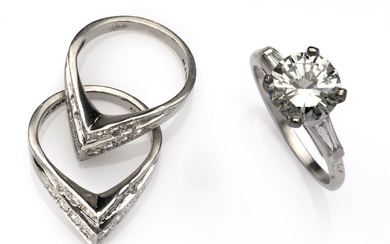 A diamond ring with two side rings