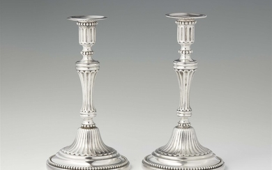 A rare pair of Turin silver candlesticks