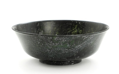 A 20th centurty Chinese dark green jade bowl. Weight app. 404 gr. H. 7. diam. 19 cm.