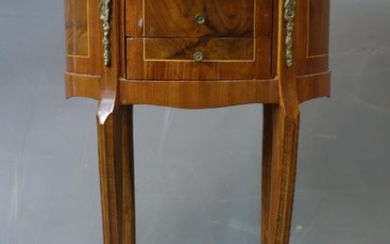 A 20th century French walnut oval lamp table, with 3 drawers...