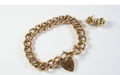 A 9CT GOLD CURB LINK BRACELET with padlock clasp, each link ...