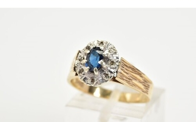A 9CT GOLD SAPPHIRE AND DIAMOND RING, of a tiered cluster de...