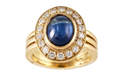 A CABACHON SAPPHIRE AND DIAMOND CLUSTER RING, mounted in 18c...