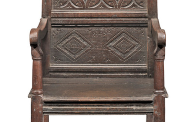 A Charles II joined oak panel-back open armchair, North Country, circa 1670 and later