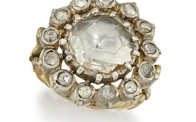A DIAMOND CLUSTER RING The central rose-cut diamond