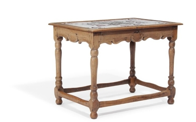 A Danish 20th century Baroqu style oak table, top with 24 Dutch 19th century faiance tiles. H. 88. L. 89. W. 63 cm.