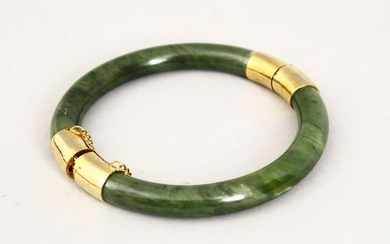 A GOOD 19TH CENTURY CHINESE CARVED JADE BANGLE, with