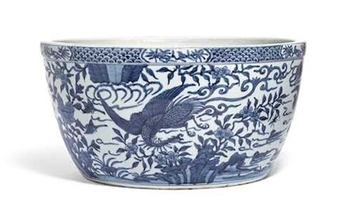 A LARGE BLUE AND WHITE FISH BOWL.