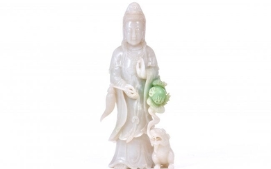 A LARGE WHITE JADE FIGURE OF GUANYIN