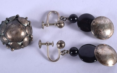 A PAIR OF ABSTRACT SILVER EARRINGS with matching