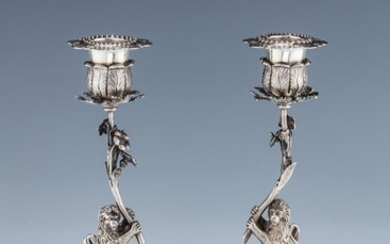 A PAIR OF SILVER JUDAIC SABBATH CANDLESTICKS. Most likely...