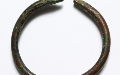 A ROMAN BRONZE BANGLE WITH SNAKE HEAD.