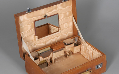 A STITCHED HIDE TRAVEL CASE WITH SILVER MOUNTED FITTINGS.