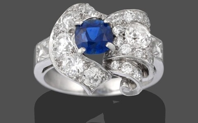 A Sapphire and Diamond Cluster Ring, the central round cut...