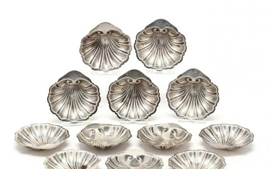 A Set of Twelve Sterling Silver Shell Form Butter Pats