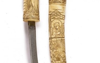 A TANTO WITH CARVED DECORATIONS