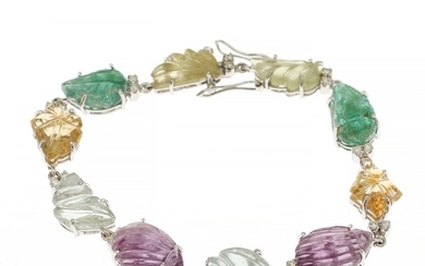 A Tutti Frutti bracelet set with carved emerald, aquamarine, amethyst and citrine, and numerous brilliant-cut diamonds, mounted in 14k white gold.