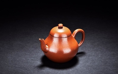A YIXING RED CLAY PEAR-SHAPED TEAPOT