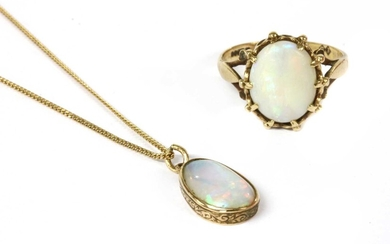 A gold single stone opal pendant