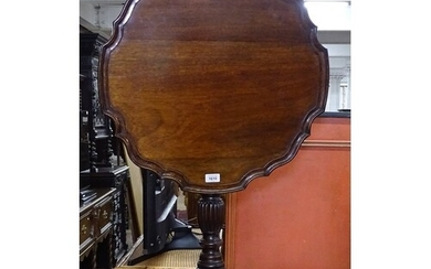 A mahogany Chippendale style tilt-top table, with pie crust ...