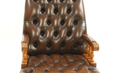 A modern buttoned leather upholstered high back office chair
