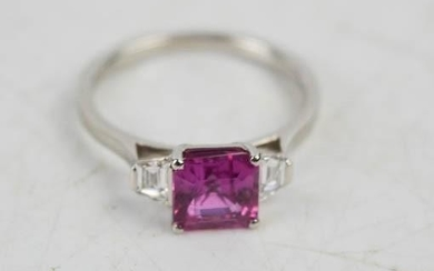 A platinum, pink sapphire and diamond ring, the square cut p...