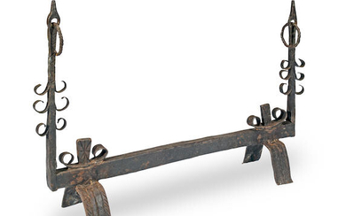 A rare double-ended wrought iron fire dog