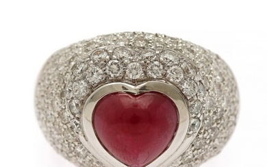 A ruby and diamond ring set with a hear-shaped ruby encircled by numerous diamonds, totalling app. 2.10 ct., mounted in 18k white gold. Size 55.