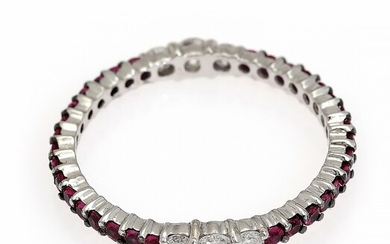 NOT SOLD. A ruby and diamond ring set with six diamonds and numerous rubies, mounted...