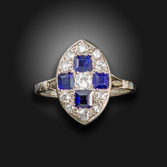 A sapphire and diamond lozenge ring, set with graduated old...