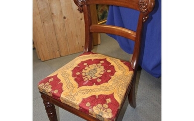 A set of six early 19th century mahogany dining chairs with ...