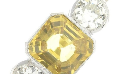 A yellow sapphire and diamond three-stone ring.Sapphire