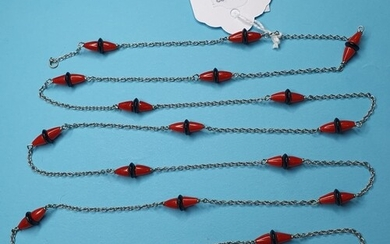 An Art Deco white gold, onyx and coral long chain