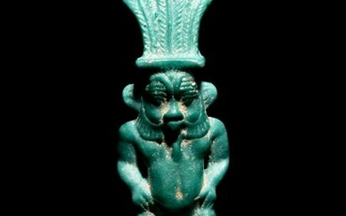 An Egyptian Faience Amulet of Bes Height 2 7/8 inches.