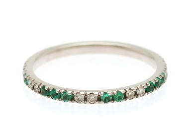 An emerald and diamond eternity ring set with numerous circular-cut emeralds and brilliant-cut diamonds, mounted in 18k white gold. Size 52.