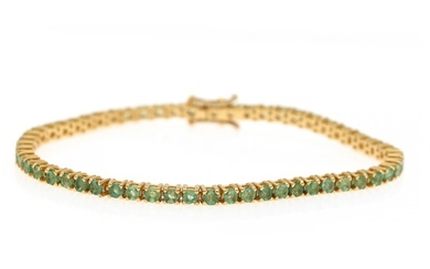 An emerald bracelet set with numerous circular-cut emeralds, totalling app. 4.23 ct., mounted in 18k gold. W. 3 mm. L. 18 cm.