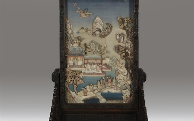 An impressive pair of Chinese bone-embellished and carved hardwood...