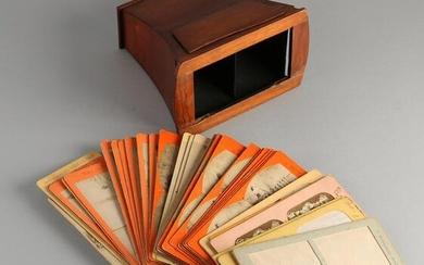 Antique mahogany stereo viewer with various paper