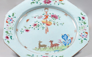 Chinese porcelain dish. Qianlong, 18th century. Octagonal in shape, decorated with the enamels of the Rose Family, in the middle of deer in a landscape with rocks and surmounted by flowering branches and a gourd hanging, bunches of flowers on the wing...