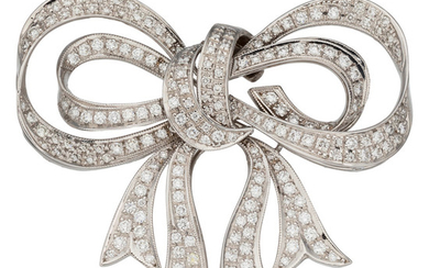 Diamond, White Gold Brooch The bow brooch features full-cut...