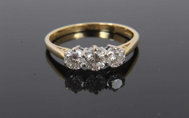 Diamond three stone ring with three round brilliant cut diamonds estimated to weigh approximately 1.00ct in total on 18ct gold shank