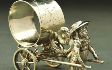 GIRL WITH CART FIGURAL NAPKIN RING.