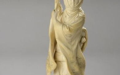 Ivory okimono carved and enhanced with ink, woman...