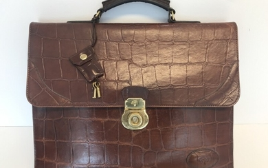 Mulberry: A bag made of brown leather with gold toned hardware, short handle, three compartments with one inside zipped pocket.