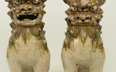 Pair of Stoneware Foo Dogs. Japan. Early 20th century.