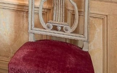 Pair of chairs in moulded, carved and grey lacquered wood, the back is openwork with a lyre motif, the legs are tapered, fluted and roughened.