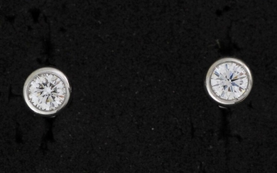 Pair of gold ear chips set with brilliants of about 0.90 carat.
